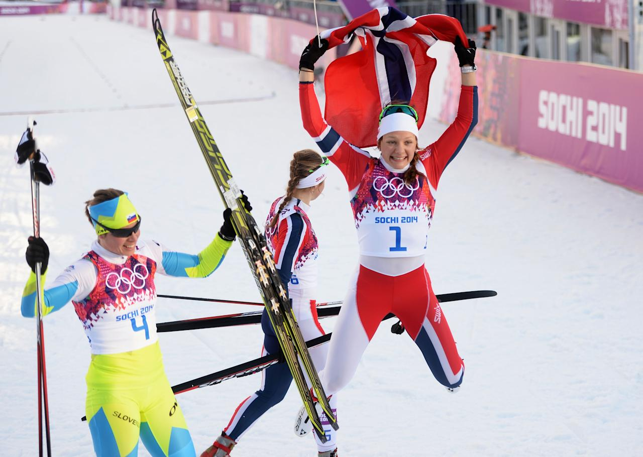 SOCHI, RUSSIA - FEBRUARY 11: Maiken Caspersen Falla of Norway (R) and Vesna Fabjan of Slovenia celebrate after winning first and third place in the Finals of the Ladies' Sprint Free during day four of the Sochi 2014 Winter Olympics at Laura Cross-country Ski & Biathlon Center on February 11, 2014 in Sochi, Russia. (Photo by Harry How/Getty Images)