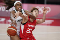 Nigeria's Erinma Ogwumike (31, left, tries to steal the ball from Japan's Nanako Todo (20) during women's basketball preliminary round game at the 2020 Summer Olympics, Monday, Aug. 2, 2021, in Saitama, Japan. (AP Photo/Charlie Neibergall)