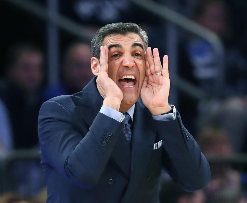 Villanova coach Jay Wright shouts to players at the other end of the court during the second half of the team's NCAA college basketball game against Marquette in the Big East men's tournament quarterfinals in New York, Thursday, March 8, 2018. Villanova defeated Marquette 94-70. (AP Photo/Kathy Willens)