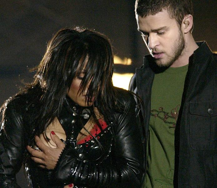 FILE - In this Sunday Feb. 1, 2004 file photo, entertainer Janet Jackson, left, covers her breast after her outfit came undone during the half time performance with Justin Timberlake at Super Bowl XXXVIII in Houston. The Supreme Court unanimously threw out fines and sanctions Thursday against broadcasters who violated the Federal Communications Commission policy regulating curse words and nudity on broadcast television. But the justices declined to issue a broad ruling on the constitutionality of the FCC indecency policy. Instead, the court concluded only that broadcasters could not have known in advance that obscenities uttered during awards show programs and a brief display of nudity on an episode of ABC's NYPD Blue could give rise to sanctions. ABC and 45 affiliates were hit with proposed fines totaling nearly $1.24 million. The stepped-up indecency enforcement, including issuing record fines for violations, also was spurred in part by widespread public outrage following Janet Jackson's breast-baring performance during the 2004 Super Bowl halftime show on CBS. (AP Photo/David Phillip, File)