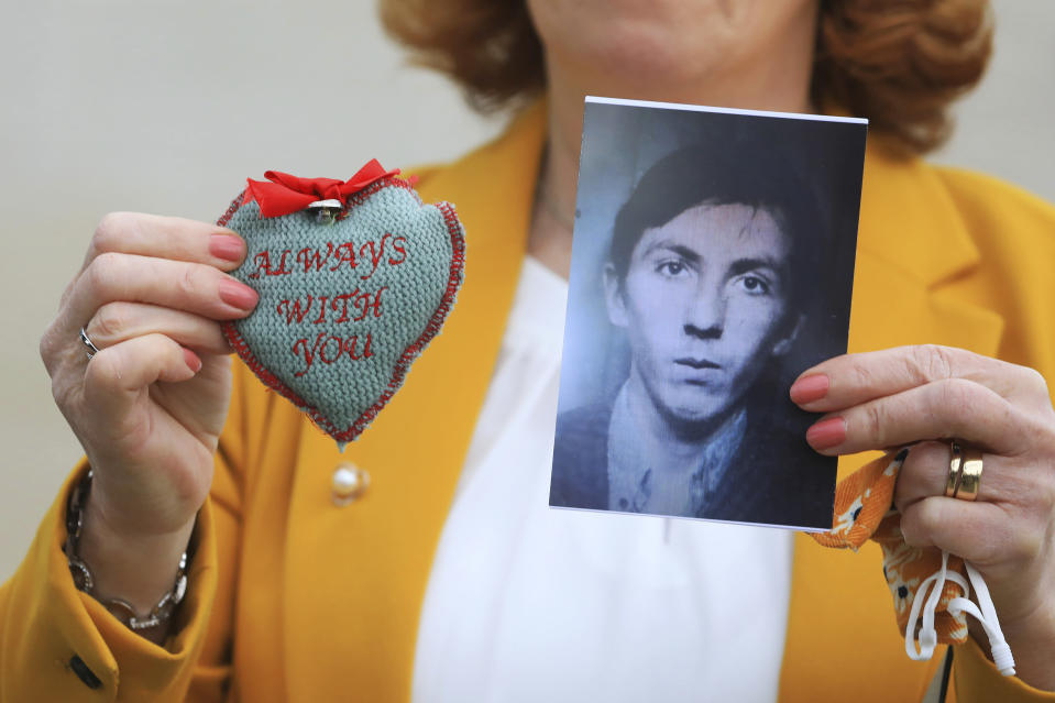 Rita Bonner holds a photograph of her brother John Laverty who was shot in Ballymurphy, ahead of the inquest into the shooting, in Belfast, Northern Ireland, Tuesday May 11, 2021. The findings of the inquest into the deaths of 10 people during an army operation in August 1971 is due to be published on Tuesday. (AP Photo/Peter Morrison)