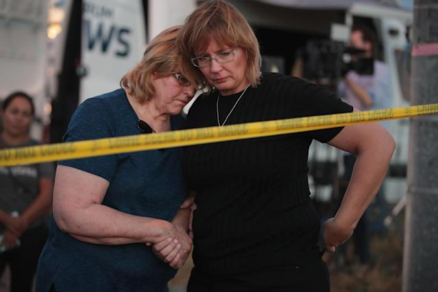 <p>Joan Stanley (L) and her daughter Kellie Hawkins embrace at a barricade near the First Baptist Church of Sutherland Springs on November 6, 2017 in Sutherland Springs, Texas. (Photo: Scott Olson/Getty Images) </p>