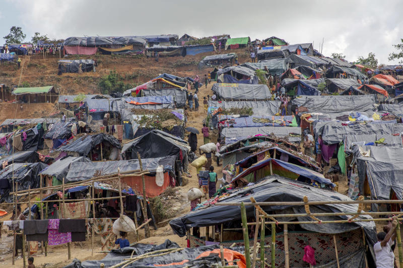 """-FILE- In this Friday, Sept. 22, 2017 file photo newly set up tents cover a hillock at a refugee camp for Rohingya Muslims who crossed over from Myanmar into Bangladesh, in Taiy Khali, Bangladesh. Gambia has filed a case at the United Nations' highest court in The Hague, Netherlands, Monday, Nov. 11, 2019, accusing Myanmar of genocide in its campaign against the Rohingya Muslim minority. A statement released Monday by lawyers for Gambia says the case also asks the International Court of Justice to order measures """"to stop Myanmar's genocidal conduct immediately."""" (AP Photo/Dar Yasin, file)"""