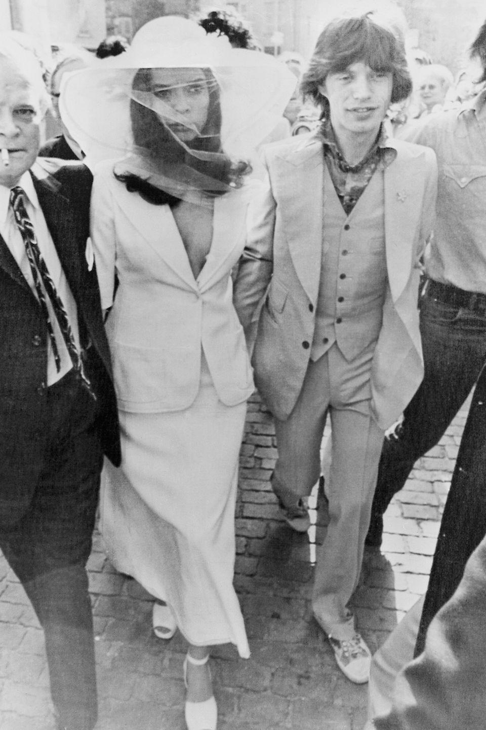 <p>The actress was truly an original when she wore a skirt suit with a plunging neckline and a veiled, wide-brim hat to marry rock star Mick Jagger. Matching ankle-strap sandals rounded out the ensemble at the small Roman Catholic ceremony in Saint-Tropez.</p>