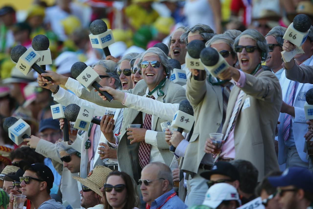 SYDNEY, AUSTRALIA - JANUARY 04: Fans dressed as Richie Benaud enjoy the atmosphere during day two of the Third Test match between Australia and Sri Lanka at Sydney Cricket Ground on January 4, 2013 in Sydney, Australia.  (Photo by Cameron Spencer/Getty Images)