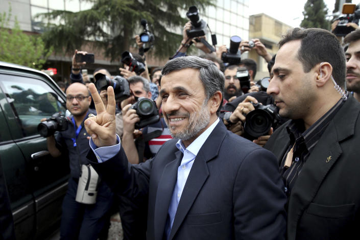 Former Iranian President Mahmoud Ahmadinejad flashes the victory sign as he arrives at the Interior Ministry to register his candidacy for the upcoming presidential elections, in Tehran, Iran, Wednesday, April 12, 2017. Ahmadinejad on Wednesday unexpectedly filed to run in the country's May presidential election, contradicting a recommendation from the supreme leader to stay out of the race. (AP Photo/Ebrahim Noroozi)