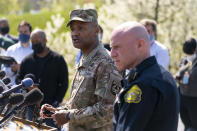 Brig. Gen. Michael J. Talley, commander of U.S. Army Medical Research and Development Command Fort Detrick, Md., left, joined by Frederick Maryland Police Chief Jason Lando, right, speaks during a news conference near the scene of a shooting at a business park in Frederick, Md., Tuesday, April 6, 2021. (AP Photo/Carolyn Kaster)