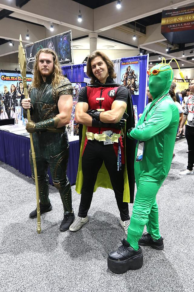 <p>Cosplayers dressed as Aquaman, Robin, and Ambush Bug from DC Comics at Comic-Con International on July 21, 2018, in San Diego. (Photo: Angela Kim/Yahoo Entertainment) </p>