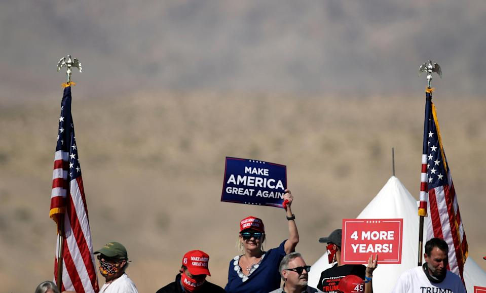 Activists project 'Trump failed us' on Arizona mountain as president hosts rally in state ((Photo by Isaac Brekken/Getty Images)