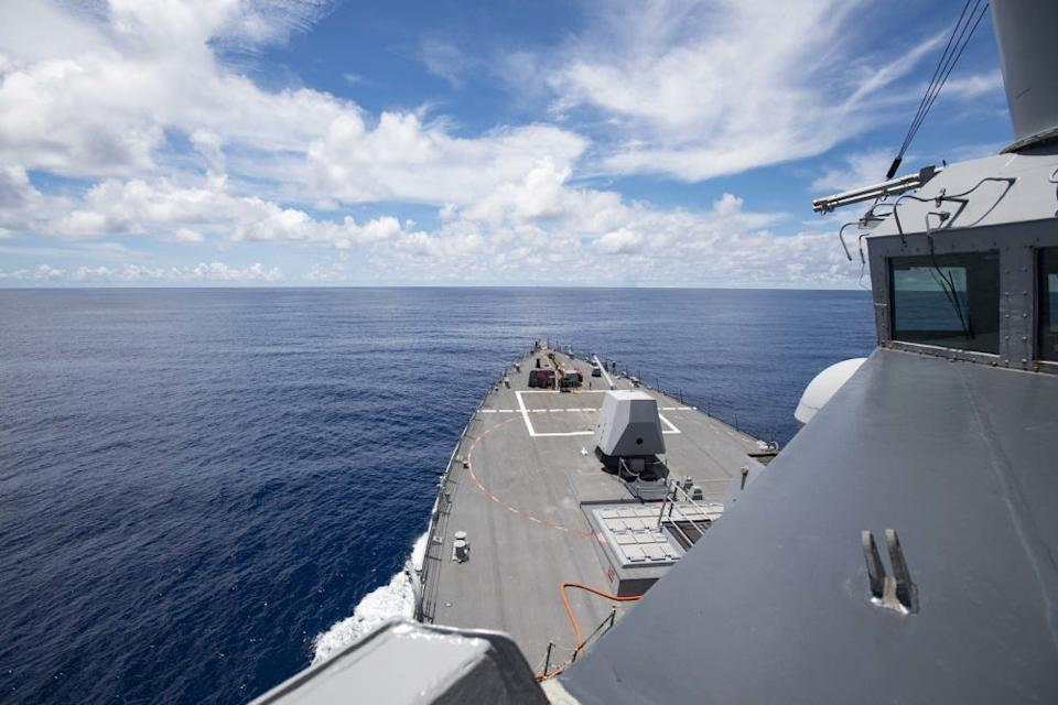 The Arleigh Burke-class guided-missile destroyer USS Ralph Johnson (DDG 114) steams near the Spratly Islands in the South China Sea. Ralph Johnson is deployed conducting maritime security operations and theater security cooperation efforts for a free and open Indo-Pacific.