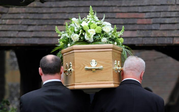A funeral takes place - PA