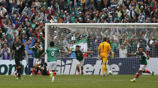 CORRECTS NAME OF PLAYER AND POSITION - Mexico's Paul Aguilar, second from left, celebrates after scoring during a 2014 World Cup playoff first round match against New Zealand in Mexico City, Wednesday, Nov. 13, 2013. (AP Photo/Eduardo Verdugo)