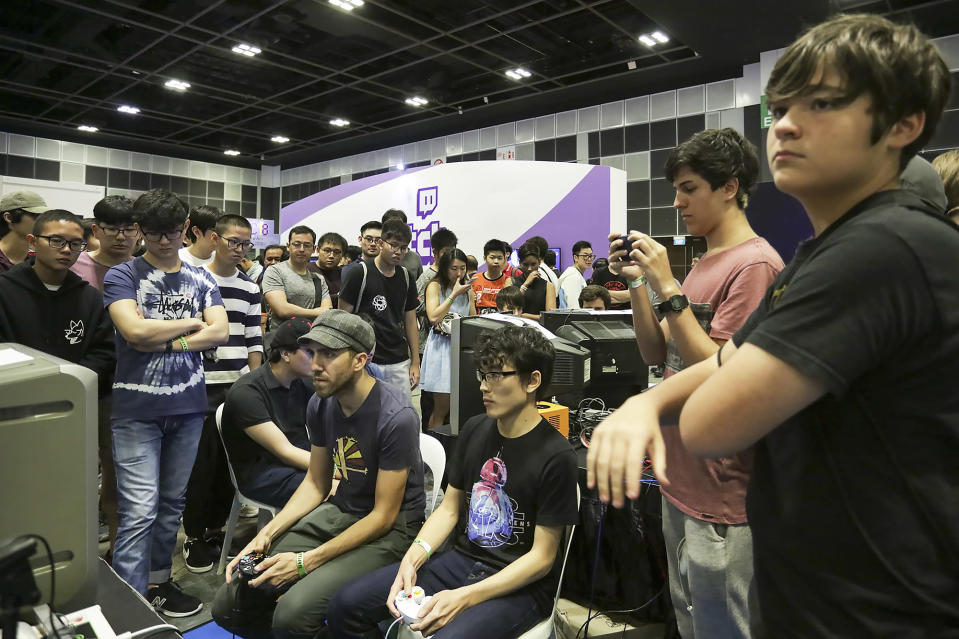 <p>Visitors at the Asia Game Festival 2018 competing on video game consoles. (PHOTO: Don Wong) </p>