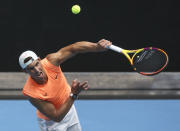 Spain's Rafael Nadal serves during a practice session ahead of the Australian Open in Melbourne, Australia, Sunday, Feb. 7, 2021.(AP Photo/Hamish Blair)