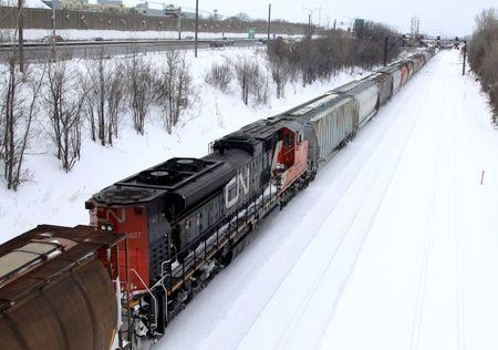 A Canadian National Railway train travels eastward on a track in Montreal
