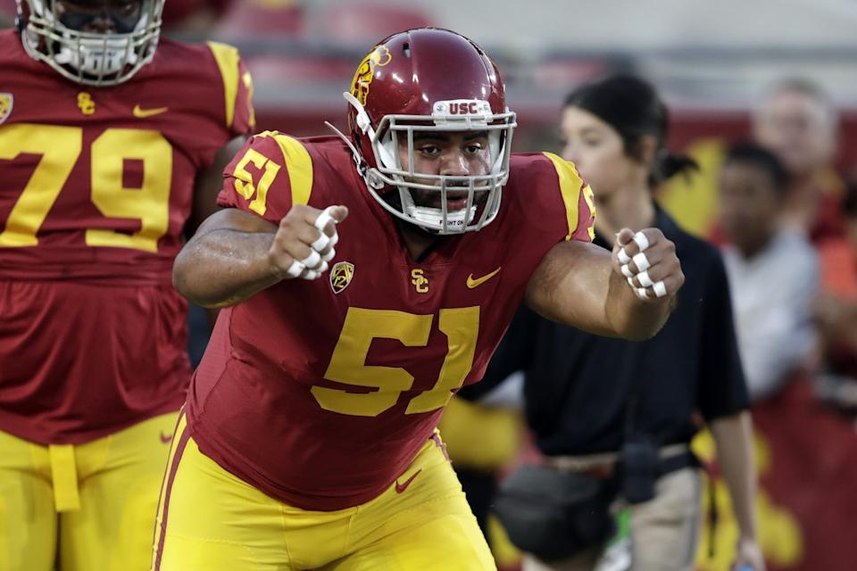 USC defensive lineman Marlon Tuipulotu warms up before playing Arizona in October 2019.