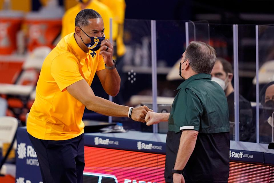 Michigan head coach Juwan Howard, left, shakes hands with Michigan State head coach Tom Izzo after the second half of an NCAA college basketball game, Thursday, March 4, 2021, in Ann Arbor, Mich. (AP Photo/Carlos Osorio)