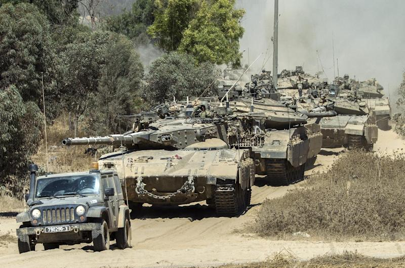 Israeli Merkava tanks roll to the southern Israeli border with the Gaza Strip, on August 1, 2014