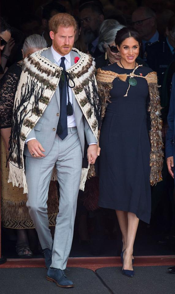 """<p>Both royals <a rel=""""nofollow"""" href=""""https://www.townandcountrymag.com/style/fashion-trends/a24450173/meghan-markle-stella-mccartney-navy-midi-dress-final-day-royal-tour-new-zealand/"""">wore traditional Maori cloaks</a> to the welcome ceremony, which is called a powhiri. </p>"""