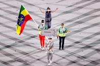 <p>TOKYO, JAPAN - JULY 23: Flag bearer Abdelmalik Muktar of Team Ethiopia during the Opening Ceremony of the Tokyo 2020 Olympic Games at Olympic Stadium on July 23, 2021 in Tokyo, Japan. (Photo by Clive Brunskill/Getty Images)</p>
