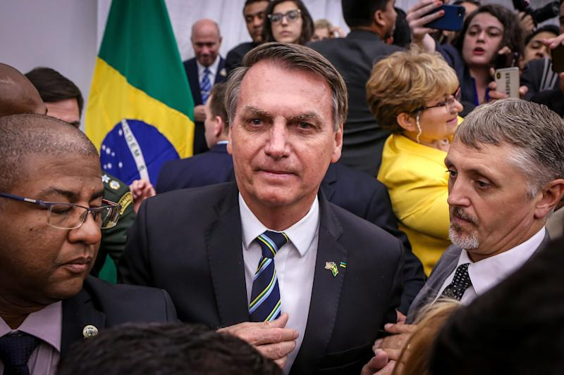 Brazilian President Jair Bolsonaro greets Miami's Brazilian community after an event at Miami Dade College's Medical Campus in Miami, Florida, on March 9, 2020. (Photo by Zak BENNETT / AFP) (Photo by ZAK BENNETT/AFP via Getty Images)