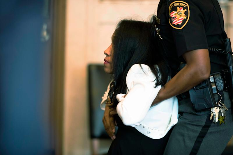Former judge Tracie Hunter is taken into custody after her execution of sentence hearing by Hamilton County Common Pleas Judge Patrick T. Dinkelacker, Monday, July 22, 2019 in Cincinnati. Hunter was ordered to serve a six-month jail sentence that was imposed more than four years ago.