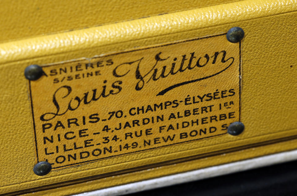 PARIS, FRANCE - APRIL 12: The logo of the leather goods maker Louis Vuitton is on display on a vintage trunk during an exhibition at the Drouot auction house on April 12, 2021 in Paris, France. These bags, suitcases and trunks from the French luxury leather goods house Louis Vuitton will be auctioned off by the Gros & Delettrez auction house on April 13, 2021 in Paris. (Photo by Chesnot/Getty Images)