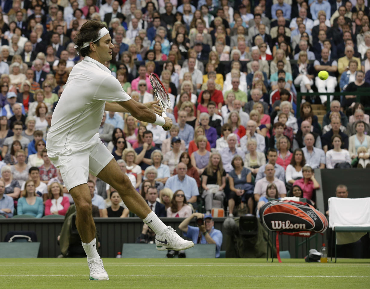 Roger Federer of Switzerland plays a shot to Novak Djokovic of Serbia during a semifinals match at the All England Lawn Tennis Championships at Wimbledon, England, Friday, July 6, 2012. (AP Photo/Anja Niedringhaus)