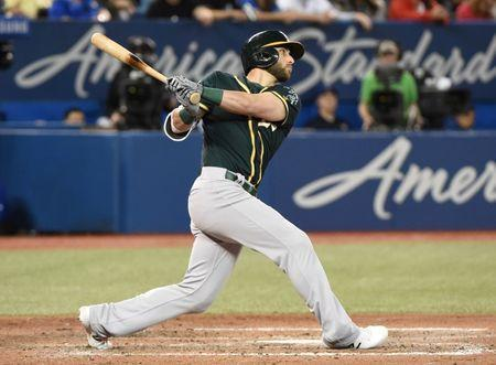 May 18, 2018; Toronto, Ontario, CAN; Oakland Athletics center fielder Dustin Fowler (11) hits a double to score a run against Toronto Blue Jays in the seventh inning at Rogers Centre. Mandatory Credit: Dan Hamilton-USA TODAY Sports