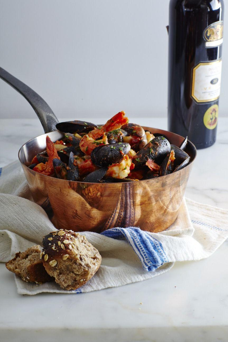 """<p>If you decide to skip meat altogether, this seafood medley is just as hearty; fresh shrimp, cod, and mussels are steamed to perfection in a single pot. It can be served <a href=""""https://www.goodhousekeeping.com/food-products/g30648453/best-pasta-brands/"""" rel=""""nofollow noopener"""" target=""""_blank"""" data-ylk=""""slk:alongside whole grain pasta"""" class=""""link rapid-noclick-resp"""">alongside whole grain pasta</a> or rice (and maybe just a slice of bread or two!).</p><p><strong>RELATED</strong><strong>: </strong><a href=""""https://www.goodhousekeeping.com/food-recipes/healthy/g721/healthy-side-dishes/"""" rel=""""nofollow noopener"""" target=""""_blank"""" data-ylk=""""slk:Healthy Side Dishes That Can Pair Well With Any Protein"""" class=""""link rapid-noclick-resp"""">Healthy Side Dishes That Can Pair Well With Any Protein</a><br></p><p><em><a href=""""https://www.goodhousekeeping.com/food-recipes/easy/a35776/cioppino/"""" rel=""""nofollow noopener"""" target=""""_blank"""" data-ylk=""""slk:Get the recipe for Cioppino »"""" class=""""link rapid-noclick-resp""""><em>Get the recipe for Cioppino »</em></a></em></p>"""