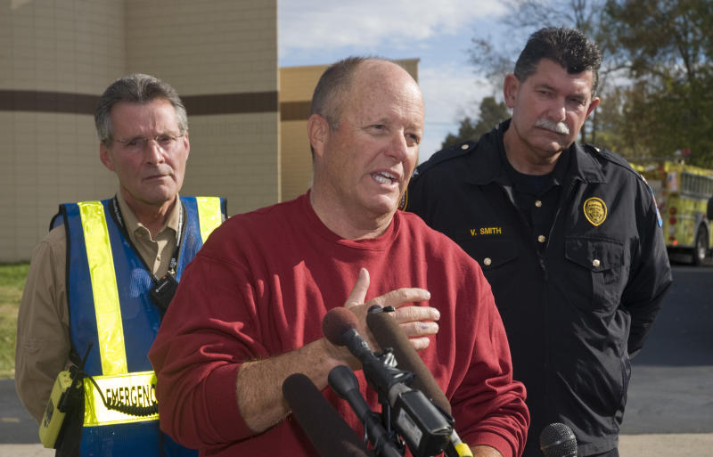 Jerald Gupton, a representative with Paducah & Louisville Railroad speaks during a news conference Thursday, Nov. 1, 2012 at the command center at Pleasure Ridge Park Fire Station # 7 on Dixie Highway in southwest Louisville, Ky. Behind Gupton is Doug Hamilton, director of Louisville and Jefferson County Emergency Management and PRP Fire Chief Vincent Smith. A Paducah & Louisville Railway train carrying hazardous chemicals derailed just after 6 a.m. EDT Monday. A leak of a potentially explosive material was contained, but authorities say three workers were severely burned in a fire that erupted while contractors were removing debris from the train Thursday in southwest Louisville. (AP Photo/Brian Bohannon)