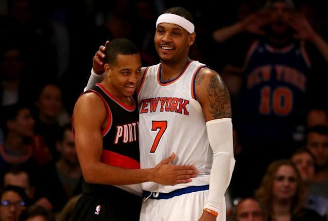 """CJ McCollum is doing everything he can to get <a class=""""link rapid-noclick-resp"""" href=""""/nba/players/3706/"""" data-ylk=""""slk:Carmelo Anthony"""">Carmelo Anthony</a> to Portland. (Getty)"""