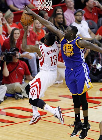 HOUSTON, TX - MAY 25: James Harden #13 of the Houston Rockets has his layup attempt blocked by Draymond Green #23 of the Golden State Warriors during Game Four of the Western Conference Finals at Toyota Center on May 25, 2015 in Houston, Texas. NOTE TO USER: User expressly acknowledges and agrees that, by dowloading and/or using this photograph, user is consenting to the terms and conditions of the Getty Images License Agreement. (Photo by Bob Levey/Getty Images)
