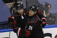 Carolina Hurricanes defenceman Jaccob Slavin (74) celebrates his goal against the New York Rangers with teammate Sebastian Aho (20) during the first period in the NHL hockey Stanley Cup playoffs in Toronto, Saturday, Aug. 1, 2020. (Frank Gunn/The Canadian Press via AP)