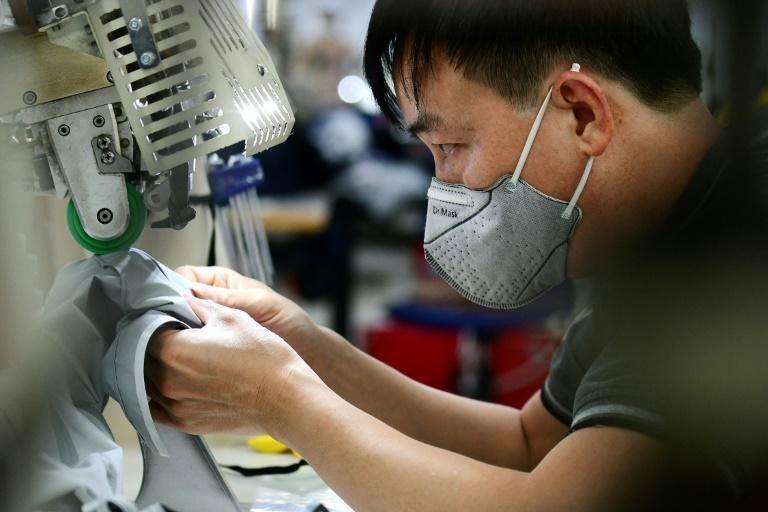 The snarl-ups at Vietnam's factories are part of a global crisis that is sending inflation surging and raising concerns about the pandemic recovery (AFP/Nhac NGUYEN)