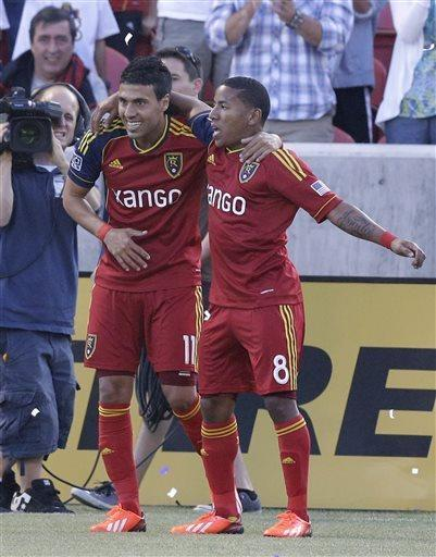 Real Salt Lake's Joao Plata (8) celebrates with teammate Javier Morales (11) after Morales scored against the San Jose Earthquakes during the first half of an MLS soccer game on Saturday, June 1, 2013, in Sandy, Utah. (AP Photo/Rick Bowmer)