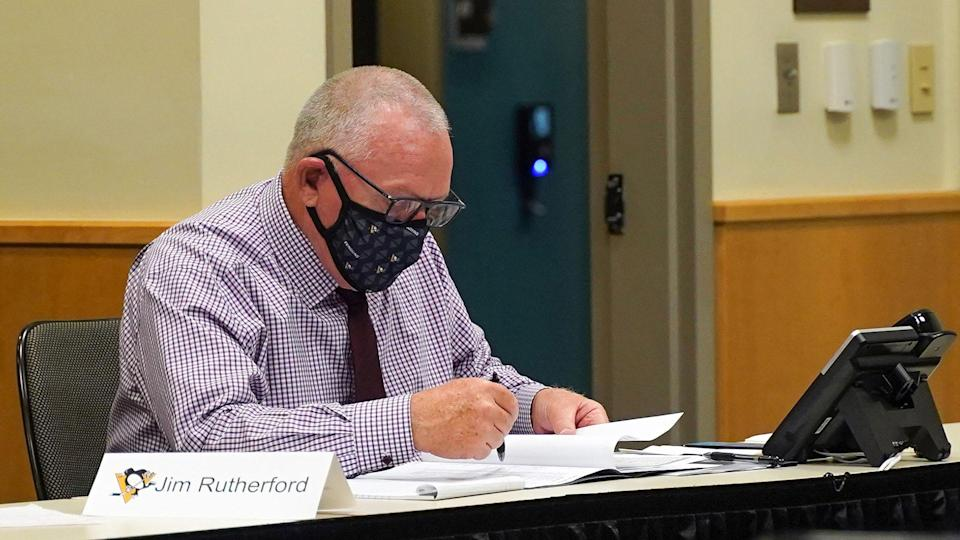 PITTSBURGH, PENNSLYVANIA- OCTOBER 07: General manager Jim Rutherford of the Pittsburgh Penguins sits at the draft table during rounds 2-7 of the 2020 NHL Entry Draft at PPG Paints Arena on October 07, 2020 in Pittsburgh, Pennsylvania. The 2020 NHL Draft was held virtually due to the ongoing Coronavirus pandemic. (Photo by Ryan Yorgen/NHLI via Getty Images)