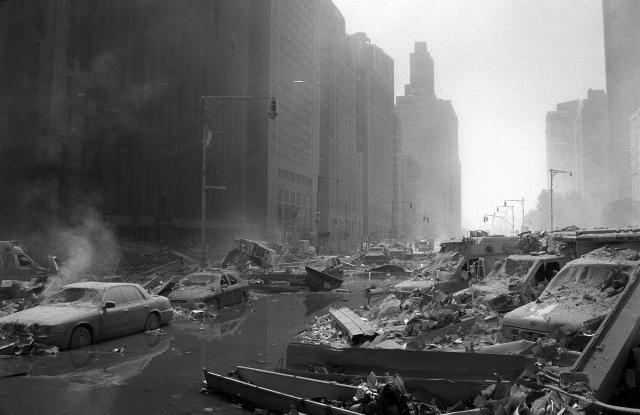 <p>West Street looking downtown is covered in rubble and damaged vehicles in the aftermath of the Sept. 11 attacks in 2001. (Photo: Shawn Baldwin/AP) </p>