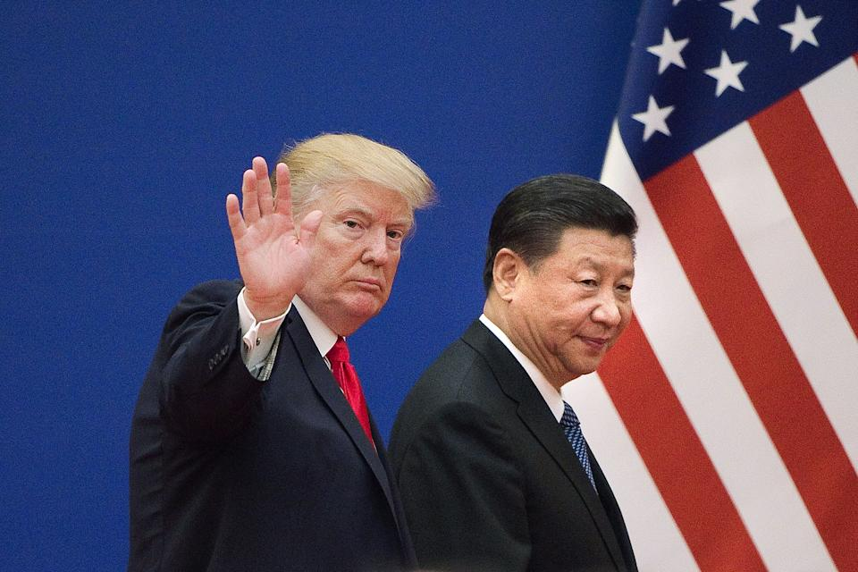 US President Donald Trump (L) and China's President Xi Jinping in 2017. Photo: NICOLAS ASFOURI/AFP/Getty Images