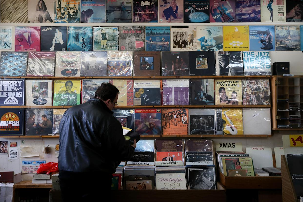 CAMBRIDGE, MA - NOVEMBER 24: Gerald Fusco examines records while shopping at Stereo Jack's on Massachusetts Avenue in Cambridge, MA on Small Business Saturday, Nov. 24, 2018. (Photo by Craig F. Walker/The Boston Globe via Getty Images)