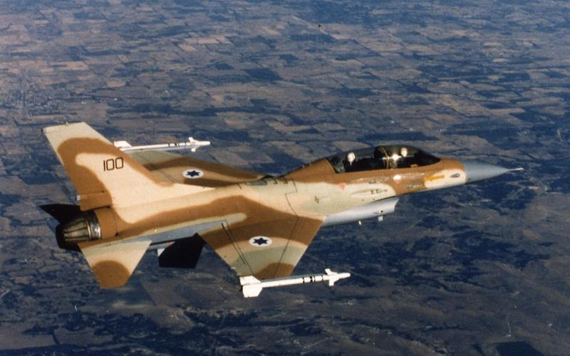 AP I ISR ISRAEL AIR FORCE F-16 JET FIGHTER...An Israeli Air Force F-16 jet fighter in flight over Israel 1980. (AP Photo/Str/HO) - STR/AP