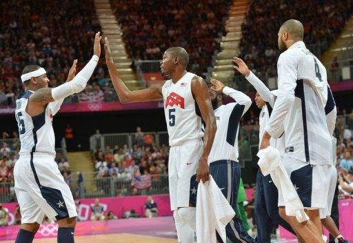US forward Carmelo Anthony (L) and US forward Kevin Durant react during the men's preliminary round basketball match USA vs Nigeria of the London 2012 Olympic Games at the basketball arena in London. The United States team of NBA stars set a record for most points in a single Olympic men's basketball game by defeating Nigeria 156-73 on Thursday in a preliminary round game