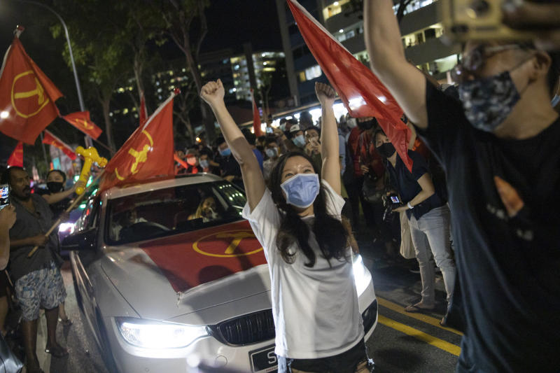 Supporters of the Workers' Party cheering at Hougang Avenue 5 in the early hours of 11 July, 2020 after the results of the general election were announced. The party won 10 seats in the House in its strongest showing to-date. (PHOTO: Don Wong for Yahoo News Singapore)