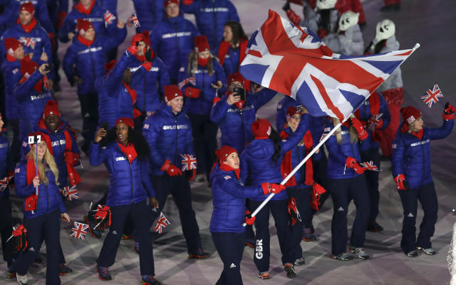 <p>Lizzy Yarnold carries the flag of Britain during the opening ceremony of the 2018 Winter Olympics in Pyeongchang, South Korea, Friday, Feb. 9, 2018. (AP Photo/Michael Sohn) </p>