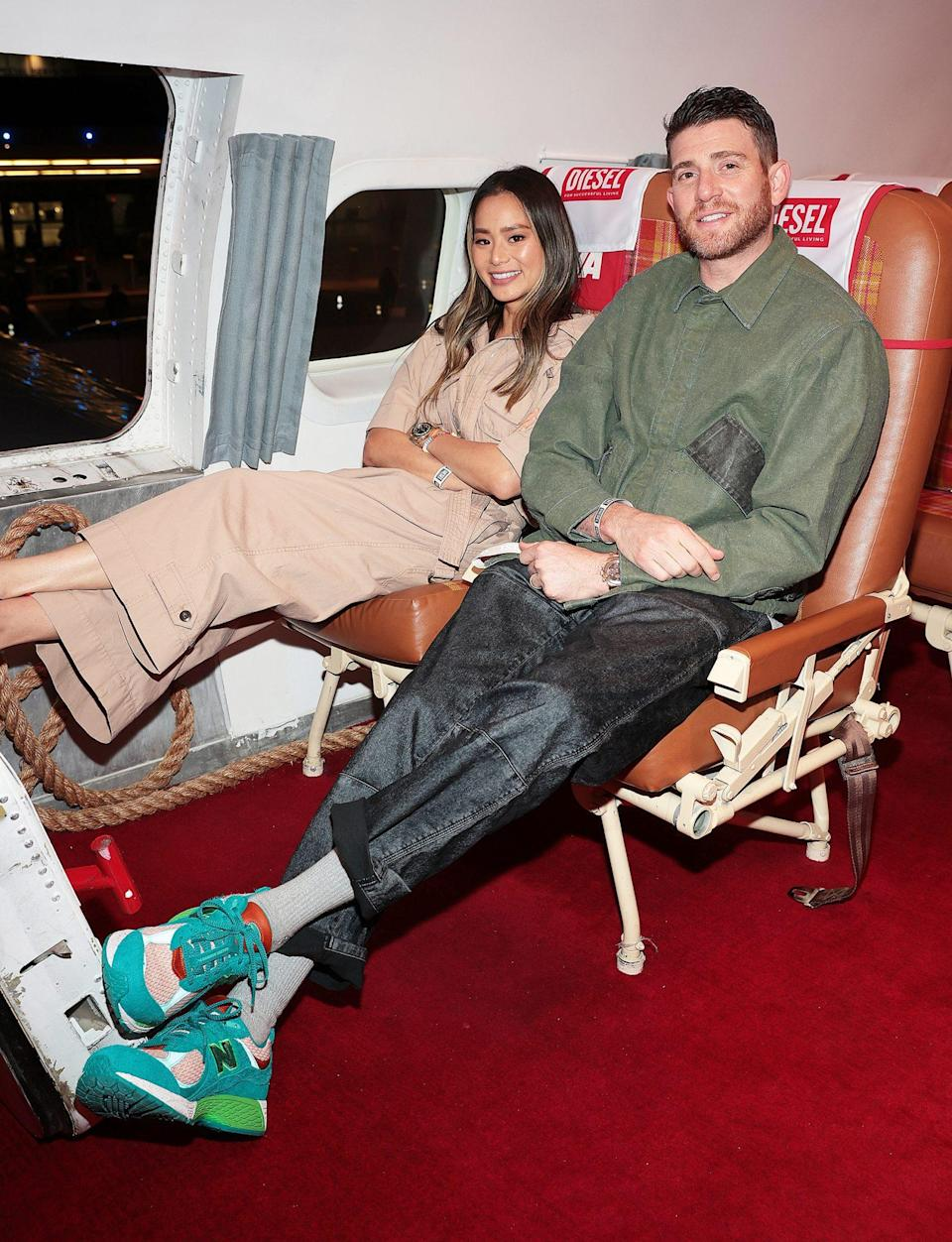<p>Jamie Chung and Bryan Greenberg sit back and relax at the Diesel event at the TWA Hotel on June 24 in N.Y.C. </p>