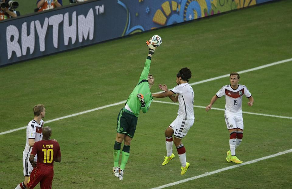 Germany's goalkeeper Manuel Neuer, centre, leaps to get a hand on the ball the ball during the group G World Cup soccer match between Germany and Ghana at the Arena Castelao in Fortaleza, Brazil, Saturday, June 21, 2014. (AP Photo/Themba Hadebe)