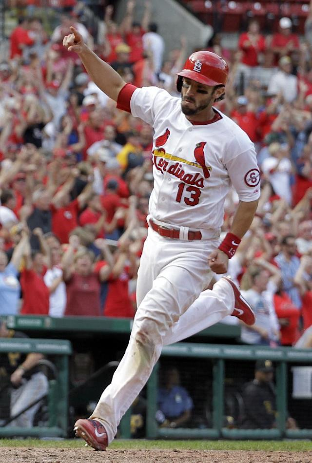 St. Louis Cardinals' Matt Carpenter celebrates as he heads home to score the game-winning run during the 12th inning of a baseball game against the Pittsburgh Pirates, Thursday, Aug. 15, 2013, in St. Louis. The Cardinals won 6-5. (AP Photo/Jeff Roberson)
