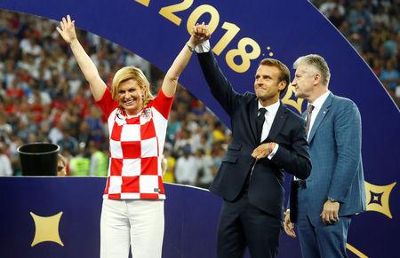 Soccer Football - World Cup - Final - France v Croatia - Luzhniki Stadium, Moscow, Russia - July 15, 2018  President of Croatia Kolinda Grabar-Kitarovic, President of France Emmanuel Macron and Croatian Football president Davor Suker on the stage before the presentation  REUTERS/Kai Pfaffenbach