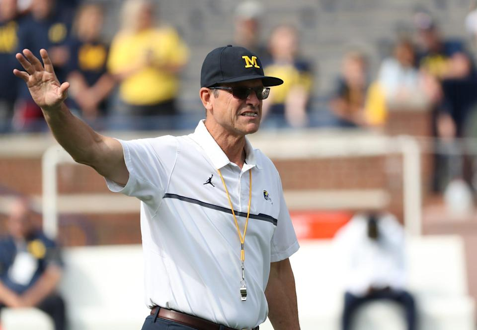 Michigan coach Jim Harbaugh on the field before the game against Western Michigan on Saturday, Sept. 4, 2021, in Ann Arbor.
