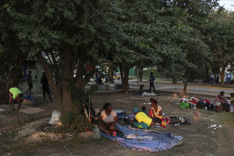 Haitian migrants wake up at an encampment at a sports park in Ciudad Acuna, Mexico, Tuesday, Sept. 21, 2021. U.S. authorities have moved to expel many of the migrants who were camped around a bridge in Del Rio, Texas, after crossing from Ciudad Acuna, Mexico. Officials are also trying to to block others from crossing the border from Mexico. (AP Photo/Felix Marquez)